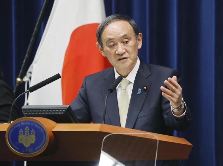 资料图:日本首相菅义伟。新华社/共同社